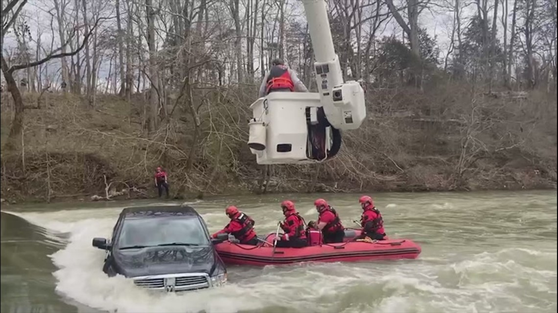 Tennessee rescuers save family after car slips off flooded bridge