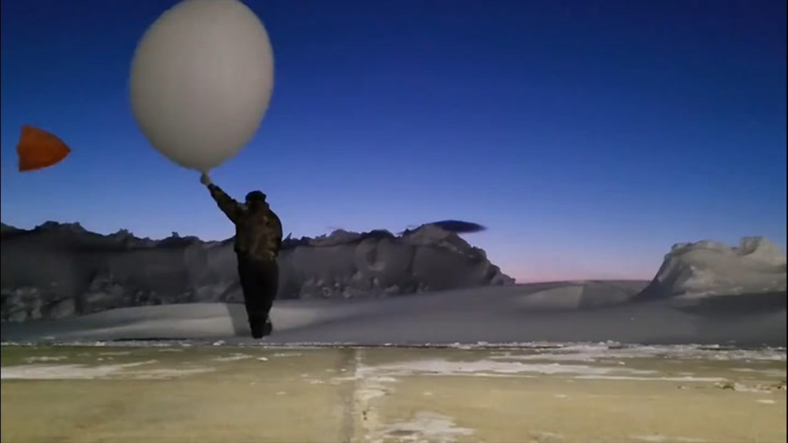 Winds pull weather balloon out of meteorologist's hands