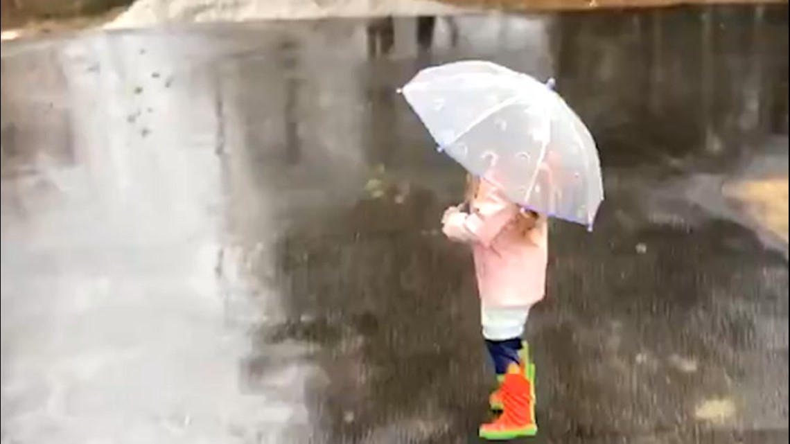 Rain drenches a snow-weary Northeast