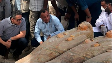 Egypt says archaeologists uncovered 20 ancient coffins