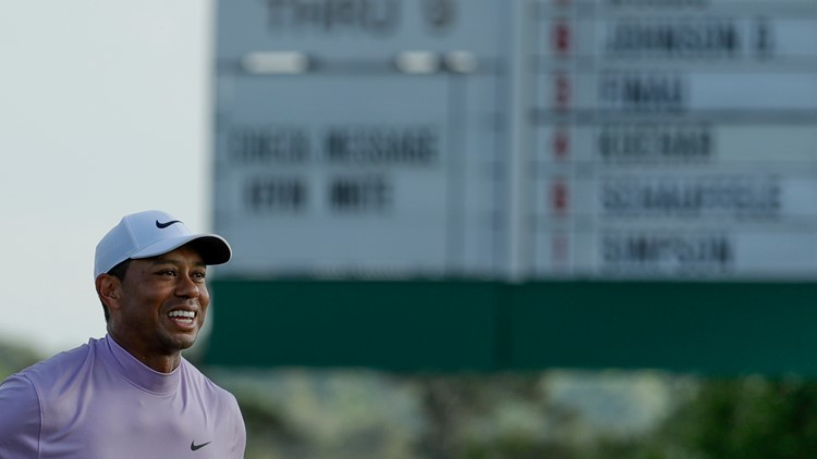 Tiger Woods smiles Masters Golf AP