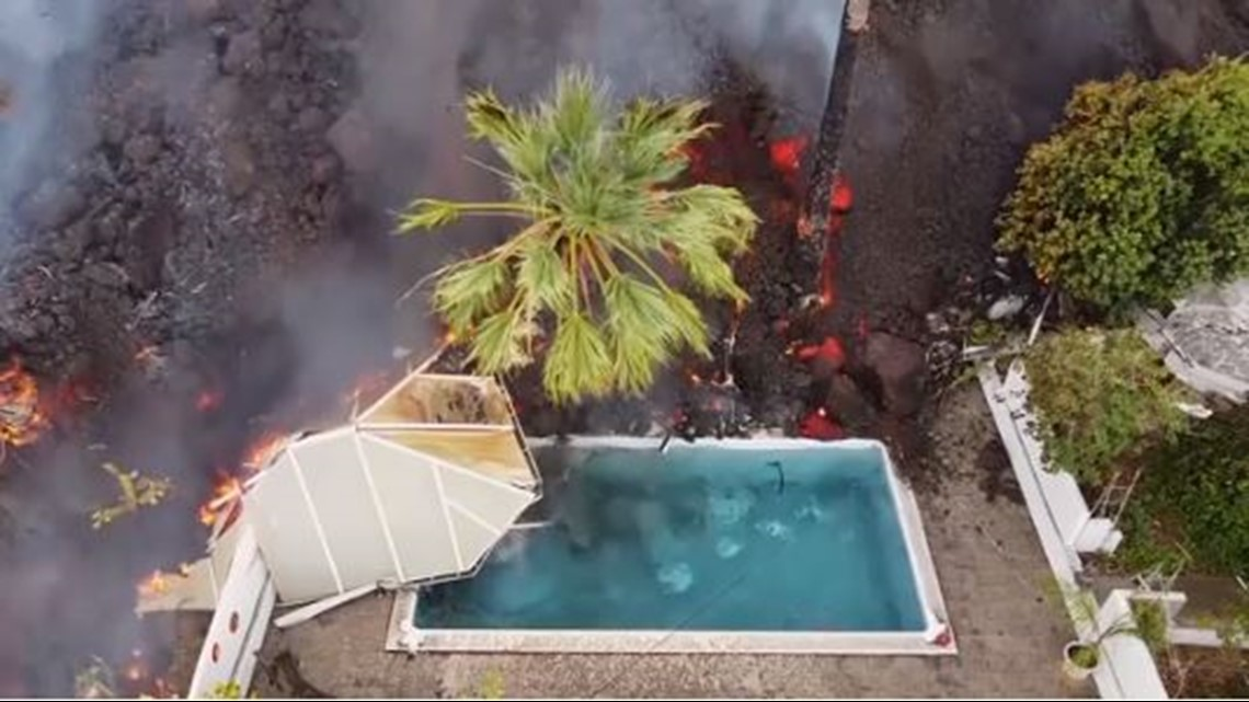 Watch Spain volcano take out swimming pool, homes