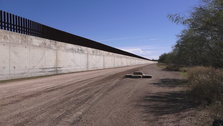Example of a levee border wall topped with steel bollard fencing
