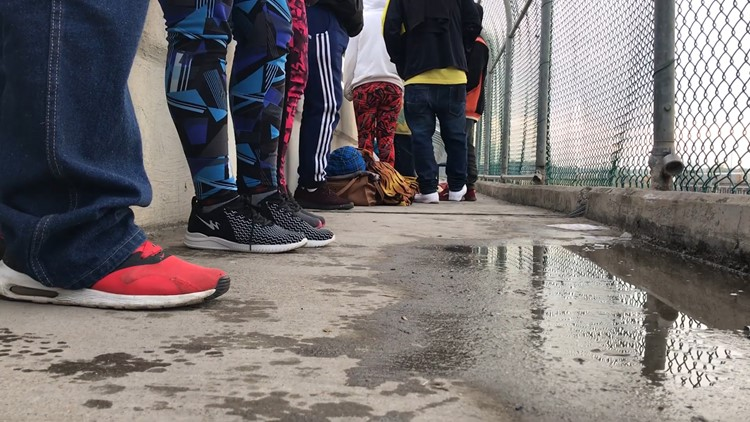 Asylum seekers wait on Mexican side of the Eagle Pass bridge in Eagle Pass, Texas