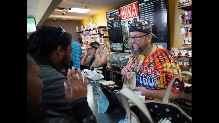 'Budtender' Jason Coleman describes the effects of a marijuana-infused lubricant to customers inside the Medicine Man cannabis dispensary in Denver on April 19, 2017.  (Photo: Trevor Hughes, USA TODAY)