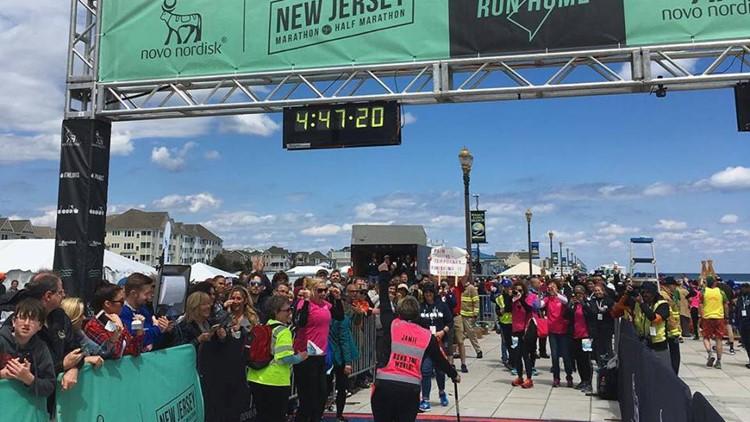 Jamie crossing marathon finish line