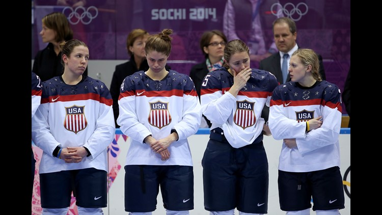 Michelle Picard, Josephine Pucci, Alex Carpenter and Kendall Coyne of the United States react during the flower ceremony after losing to Canada 3-2 during the Ice Hockey Women's Gold Medal Game of the Sochi 2014 Winter Olympics on February 20, 2014.