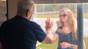 NC woman tells grandfather she's engaged through the nursing home window