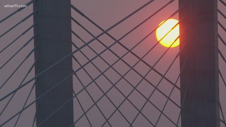 The sun falls on a hazy Louisville sky