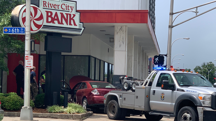 Driver hospitalized after car crashes into bank in downtown Louisville