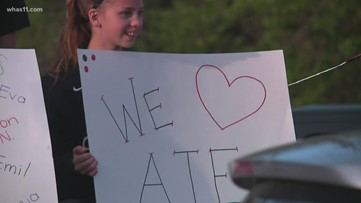 Jeffersontown school holds parade, waves to students as parents drive by