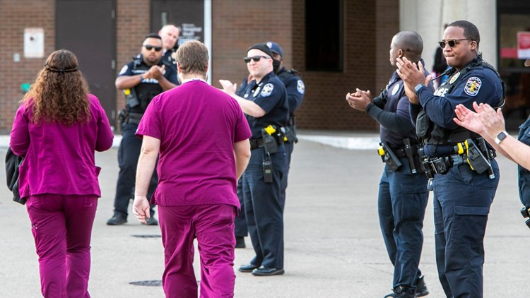 Louisville police officers thank healthcare workers during shift change