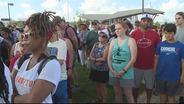 Community marches in unity after racist graffiti tagged on Big Four Bridge