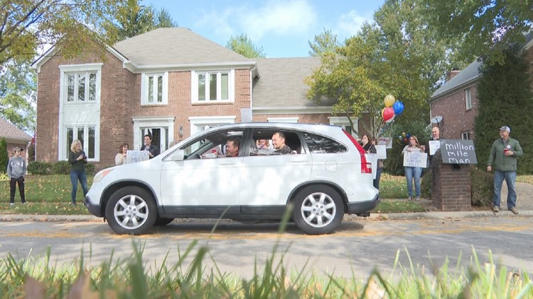The Cram Family drives Lorraine in front of their Lake Forest home in Louisville