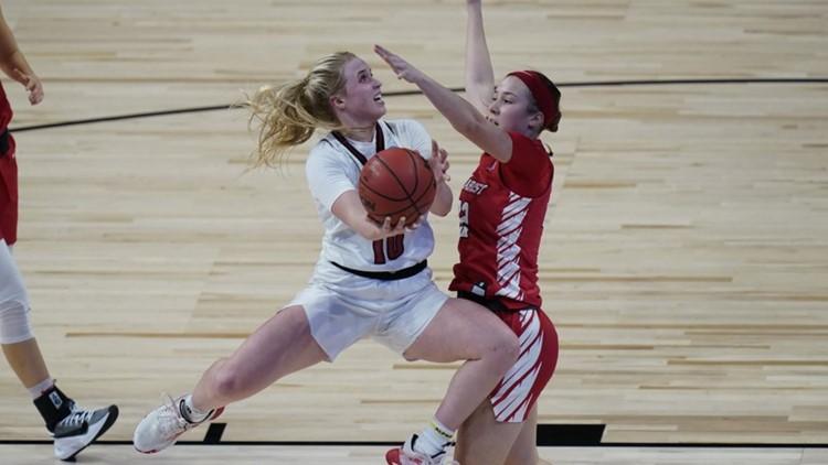 Louisville overcomes slow start to beat Marist 74-43