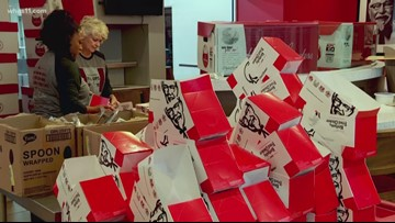 KFC employees fill buckets for the hungry