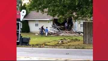 Truck crashes into Scottsburg home