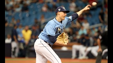 Rays use bullpen to beat Blue Jays 9-4 for 90th win