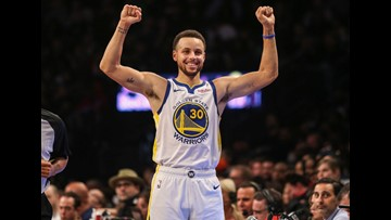 Curry sets another record for 3s, Warriors hold off Nets