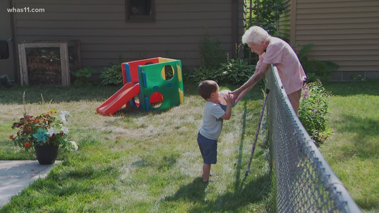 Must See: 2-year-old and a nearly 100-year-old form friendship across a backyard fence