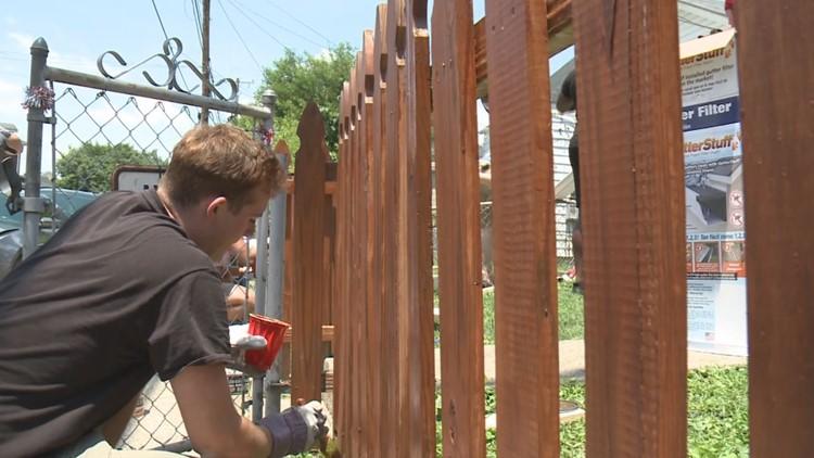 UofL Football, Habitat for Humanity team up to help Portland family