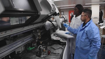Sailors inside USNS Mercy Complexity Laboratory