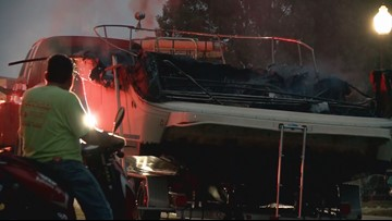 Small boat left charred after fire on Ohio River near Sherman Minton Bridge