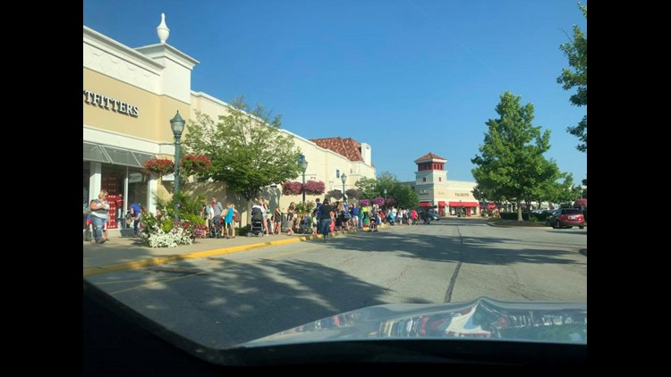 "Line outside Louisville Build-A-Bear Workshop on July 12 for ""Pay Your Age Day"" promotion."