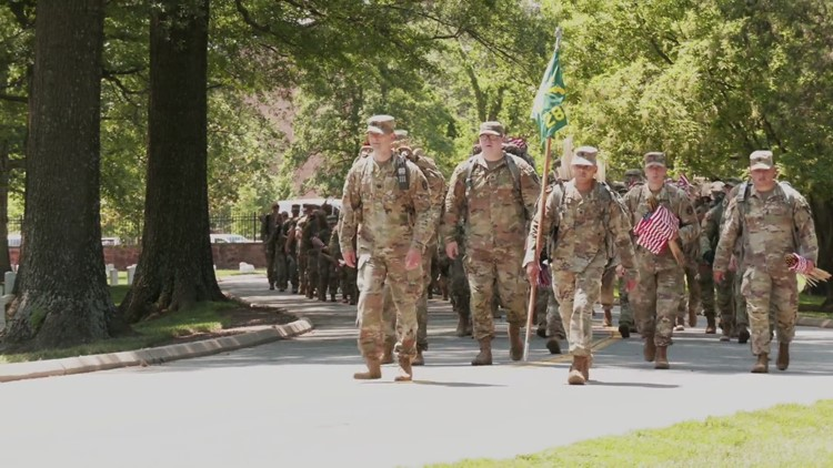 Service members from all Armed Forces place flags in Arlington National Cemetery for Memorial Day