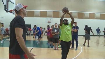 Former Cardinal Luke Hancock's basketball camp inspires children with autism