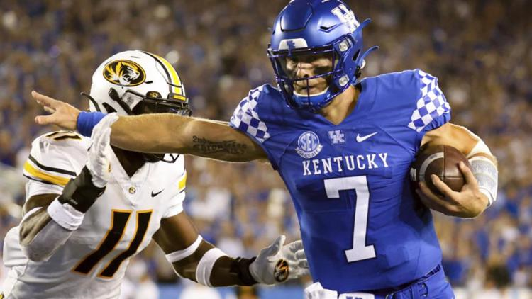 Rodriguez's 4 TDs help Kentucky hold off Missouri 35-28