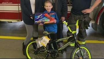 Firefighters surprise boy with new bike