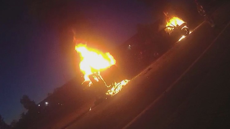Video shows LMPD officers save drivers from fiery I-65 crash