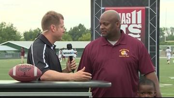 Kent talks with Doss football coach at HS GameTime