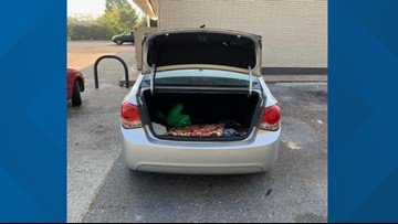 A Bowling Green woman was stopping at a gas station, but then she found a stranger in her trunk