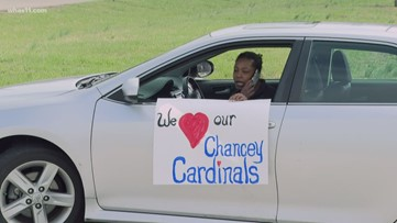Chancey Elementary School teachers do drive by parade to say hello to their students