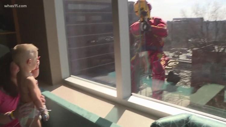 Superhero window washers bring big smiles