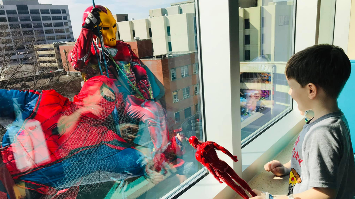 Superheroes create smiles and clean windows at Norton Children's Hospital