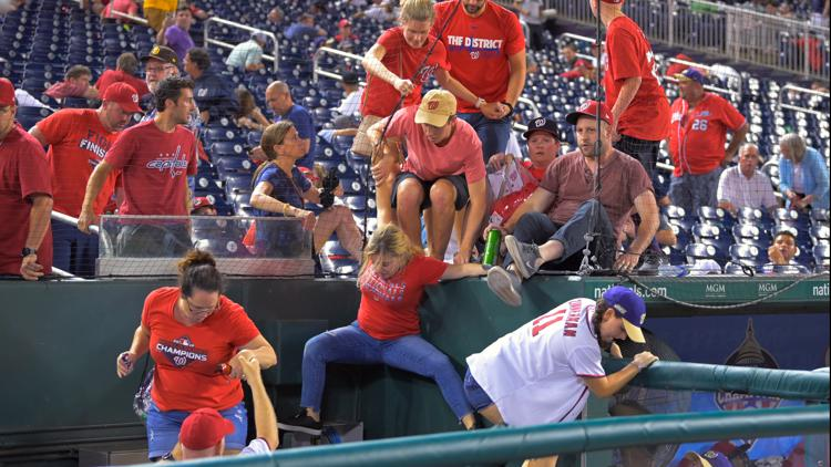Fans sent scurrying after a triple shooting outside Nats Park during a game   Police recover vehicle of interest