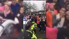 Women's March protesters serenade DC police officer