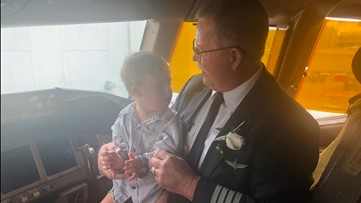 Pilot retiring after 35 years gives wings to boy who has Down syndrome