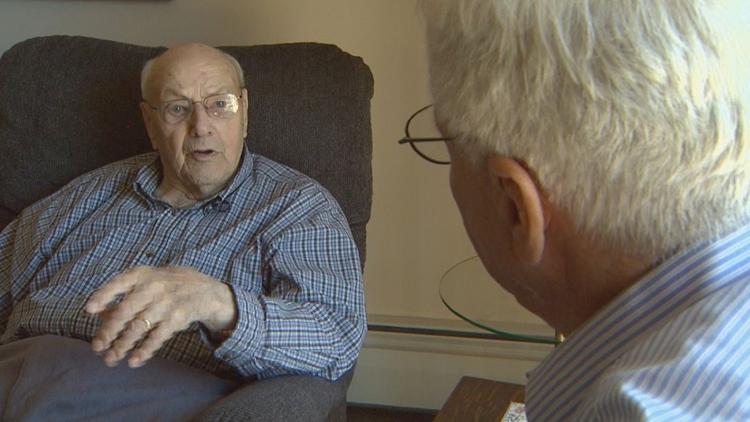 Richard Mullally meets with World War II veterans.