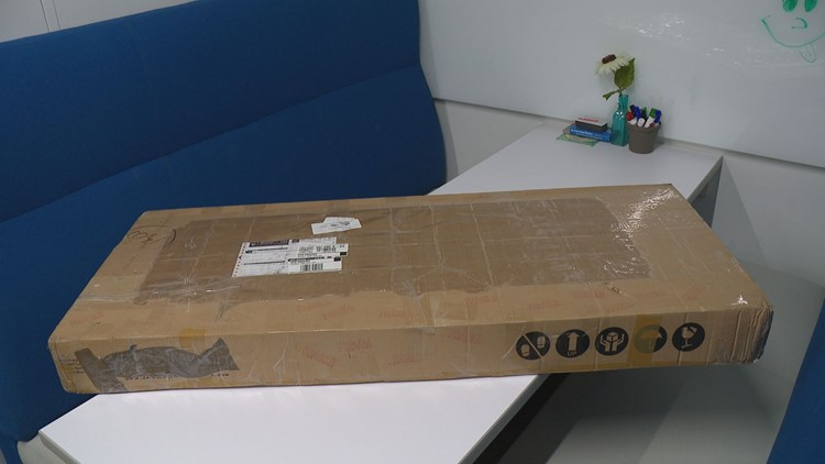 The bass guitar arrived in a huge brown box.